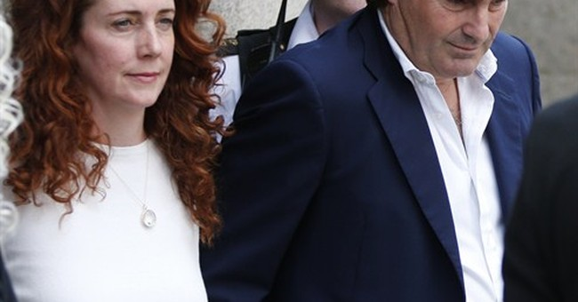 One editor convicted, one cleared in UK scandal