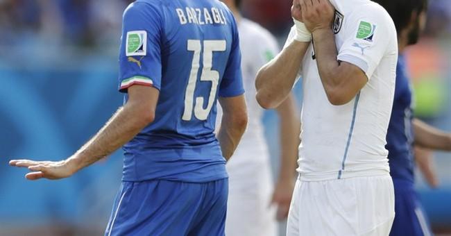 Soccer's bad boy bites opponent at World Cup