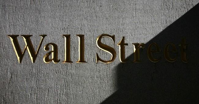 Stocks slip ahead of reports; Walgreen sinks