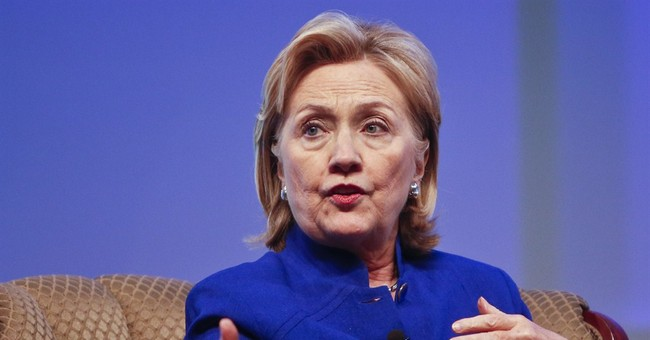 Clinton says wealth comments don't define her