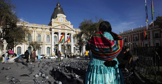 Bolivia rebels at rightist timepieces, flips clock