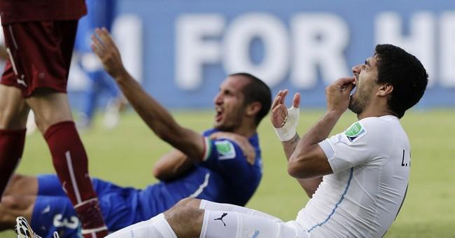 Uruguay defends Suarez as FIFA scrambles