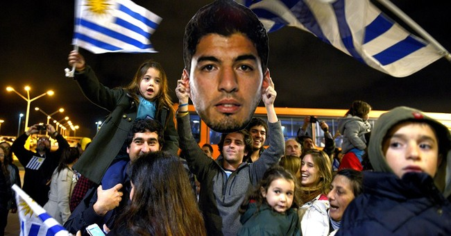 Betting company severs links with Suarez
