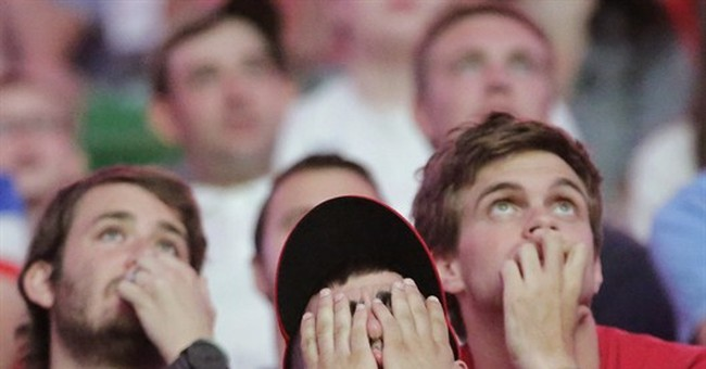 AP PHOTOS: Fans wince, cheer from DC to Berlin