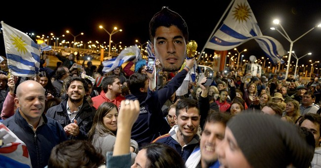 Banned Suarez back home; misses crowd in Uruguay