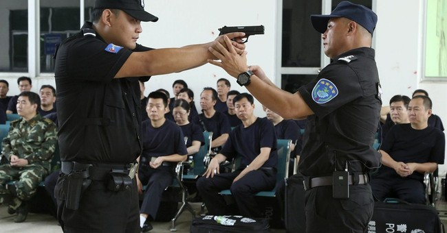 Shootings rise after China gives its police guns