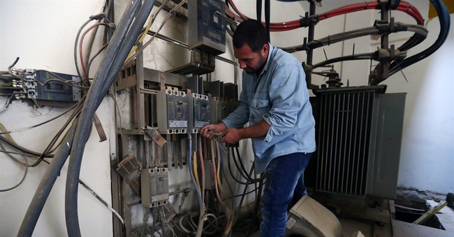 Beirut electrician keeps camp dwellers on the grid