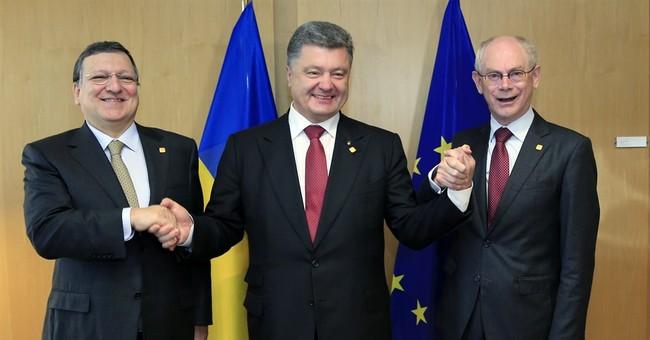 Ukraine signs historic EU pact, snubbing Russia