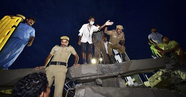 2 buildings topple in India, killing at least 19