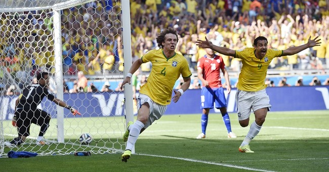 Saved by the woodwork, Brazil lives another day