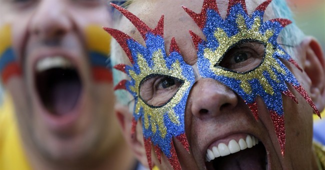 AP PHOTOS: Die-hard fans bring color to World Cup