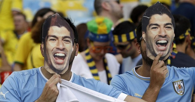 Suarez idolized, not blamed for Uruguay's exit