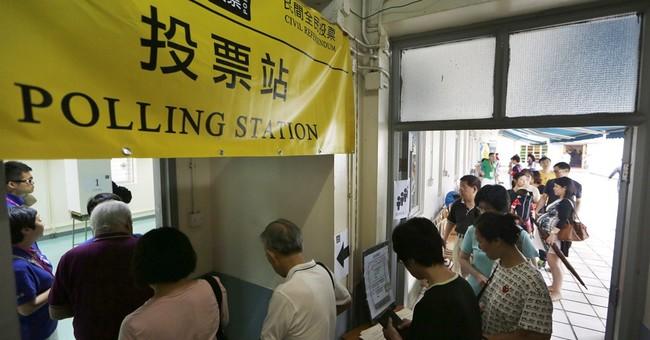 Big turnout in HK democracy vote as Beijing fumes