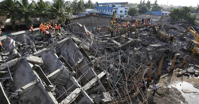 Rescuers dig for survivors in India building ruins