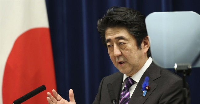 Japan's Cabinet eases post-WWII limits on military
