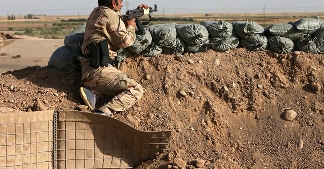 Iraqi Kurds dig frontier around disputed areas