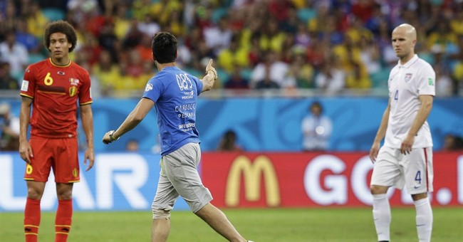 Man runs onto field during US-Belgium match