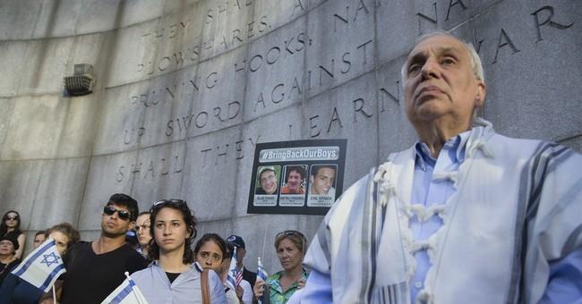 As Israel buries teens, new threats against Hamas