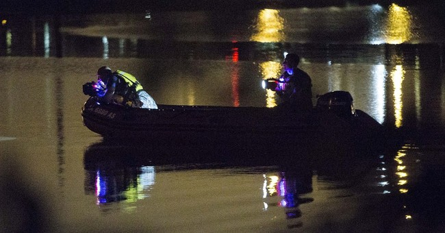 Crews search for teen in flooded Iowa storm drain