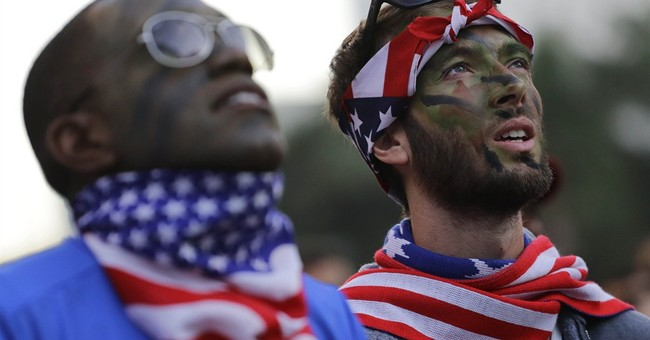 Long faces, but chins up for USA fans in Brazil