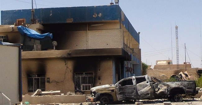 Militants try to tighten their grip in Iraq, Syria