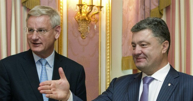 Foreign ministers agree on Ukraine cease-fire path