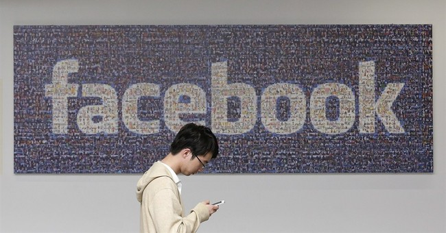 UK opens probe into Facebook's psych experiment