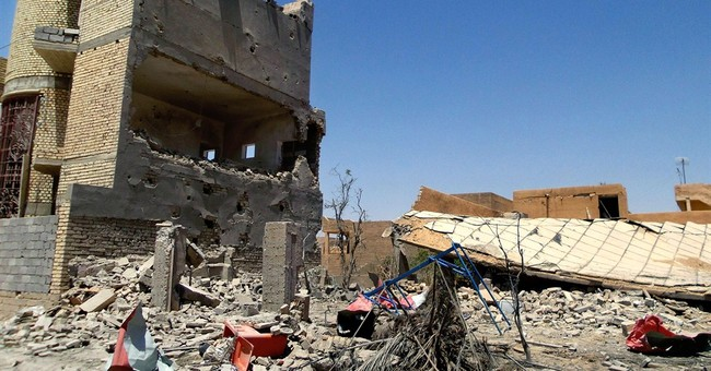 Militants try to tighten their grip in Iraq, Syria