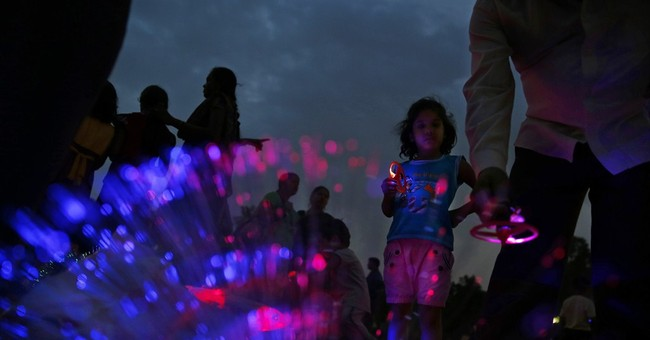 AP PHOTOS: Finding summer solace in New Delhi park