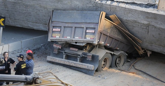 Unfinished overpass in World Cup plan falls; 2 die
