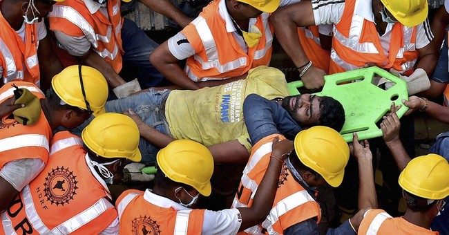 India's building collapse death toll reaches 60