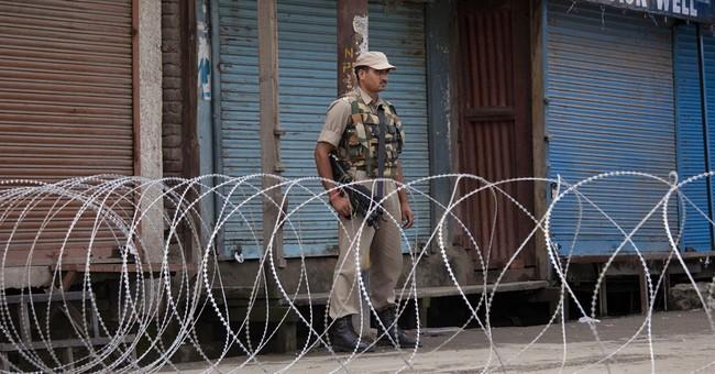 Strike, curfew shut Kashmir as India leader visits