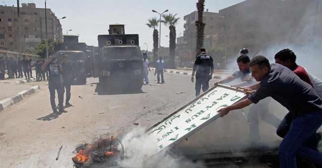 Clashes between Egypt troops, protesters kill teen