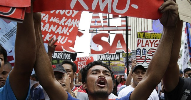 Filipino activists call for end to US defense pact
