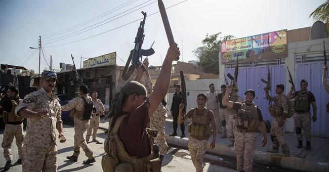 Iraq's al-Maliki signals his intent to stay in job