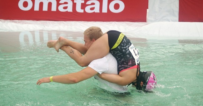 Finnish couple wins quirky 'wife carrying' race