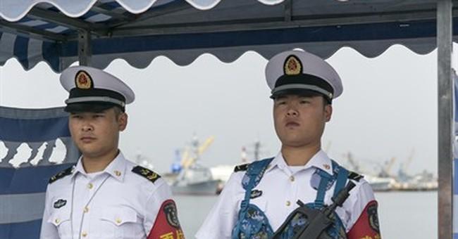 AP PHOTOS: China gives rare glimpse at naval ships