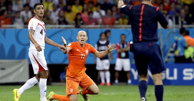 Messi guides Argentina into semis, Dutch scrape in
