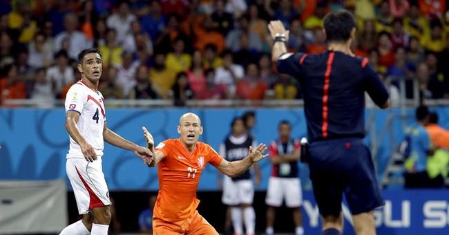 Messi guides Argentina into semis, Dutch scrape in