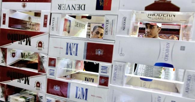 Egypt president raises cigarette, alcohol prices