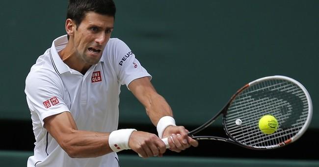 Federer wins 1st set of Wimbledon final