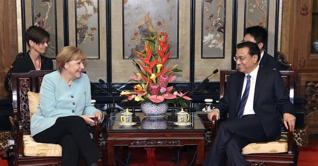 Merkel brings German business leaders to China