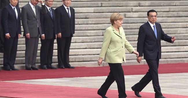 Merkel brings German business leaders to China