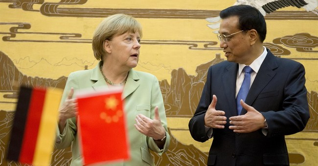 Merkel slams industrial spying on China visit