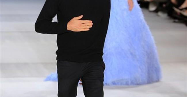 Theron, Penn dazzle Dior as fashion gets political