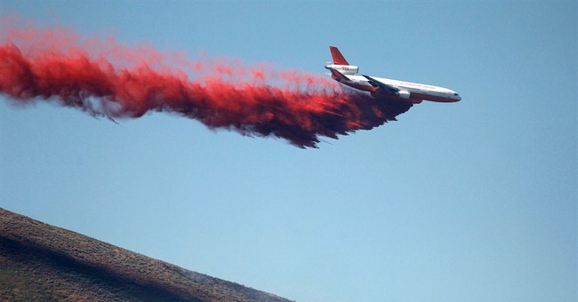 Dry conditions hinder fight vs. Western wildfires