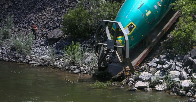 Derailed fuselages removed from Montana river