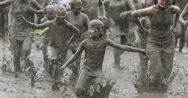 Rain + mud = messy good time for hundreds of kids