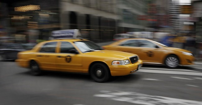 Car-hailing service Uber takes on taxis with sale