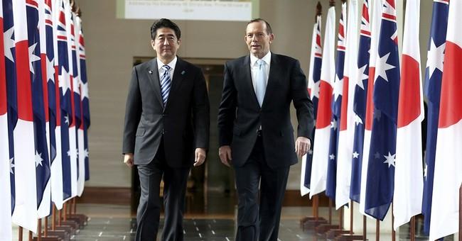 Australia, Japan sign free trade, defense deals